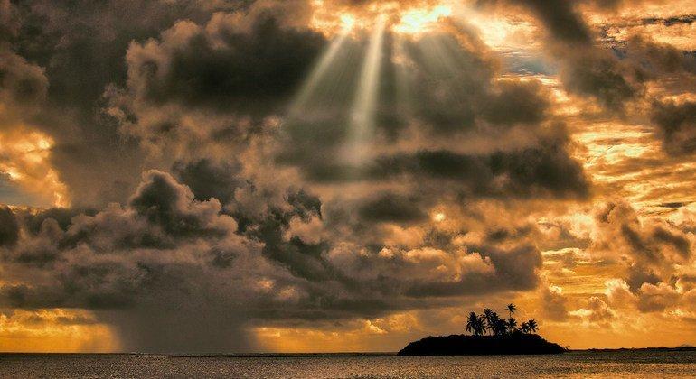 Sunrise and a rain cloud come together in Laamu Atoll, Maldives.