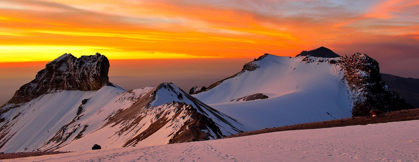 The sun rise seen from 5000 meters behind Iztaccihualt mountain in  Mexico.