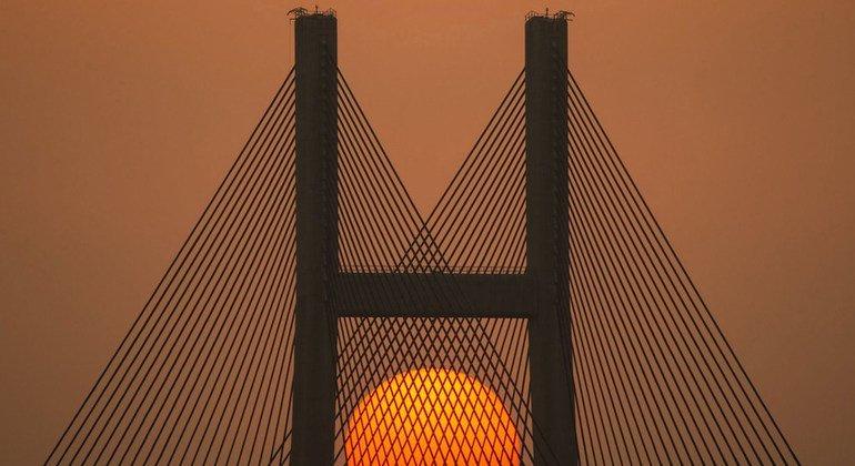 The sun sets behind the a bridge at Sai Tso Wan in Hong Kong.