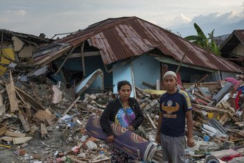 Thirty-one-year-old earthquake survivor, Mega (left) and her husband, search through the wreckage of her childhood home in Petobo village, Palu, in the Indonesian island of Sulawesi.  16 October 2018.