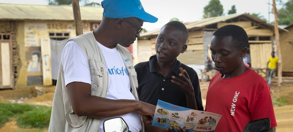 On 12 September 2018 in Beni, a UNICEF staff member discusses the best way to protect yourself against Ebola in a conversation with young people living in Beni, Democratic Republic of Congo, after a recent Ebola outbreak.