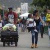 Des Vénézuéliens vulnérables cherchent de l'aide auprès de voisins colombiens de la ville frontalière de Cúcuta en octobre 2018.