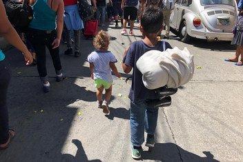 Hay muchos niños entre los migrantes centroamericanos que caminan hacia Estados Unidos. Esta foto fue tomada en Tapachulas, Chipas, México.