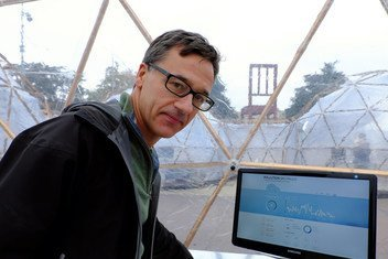 British artist Michael Pinsky, creator of The Pollution Pods exhibit at the Palais des Nations in Geneva, Switzerland.  Here, Mr. Pinsky is in the Pollution Pod representing air pollution levels in Sao Paulo.