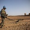 A member of the Guinean Search and Detect team of UN peacekeepers surveys a road in Kidal in the the far north of Mali in October 2018.