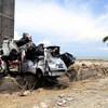 Des voitures endommagées par le séisme et le tsunami à Palu, surt l'île de Sulawesi, en Indonésie, Le séisme a provoqué un tsunami avec des vagues atteignant 20 pieds. 14 octobre 2018.