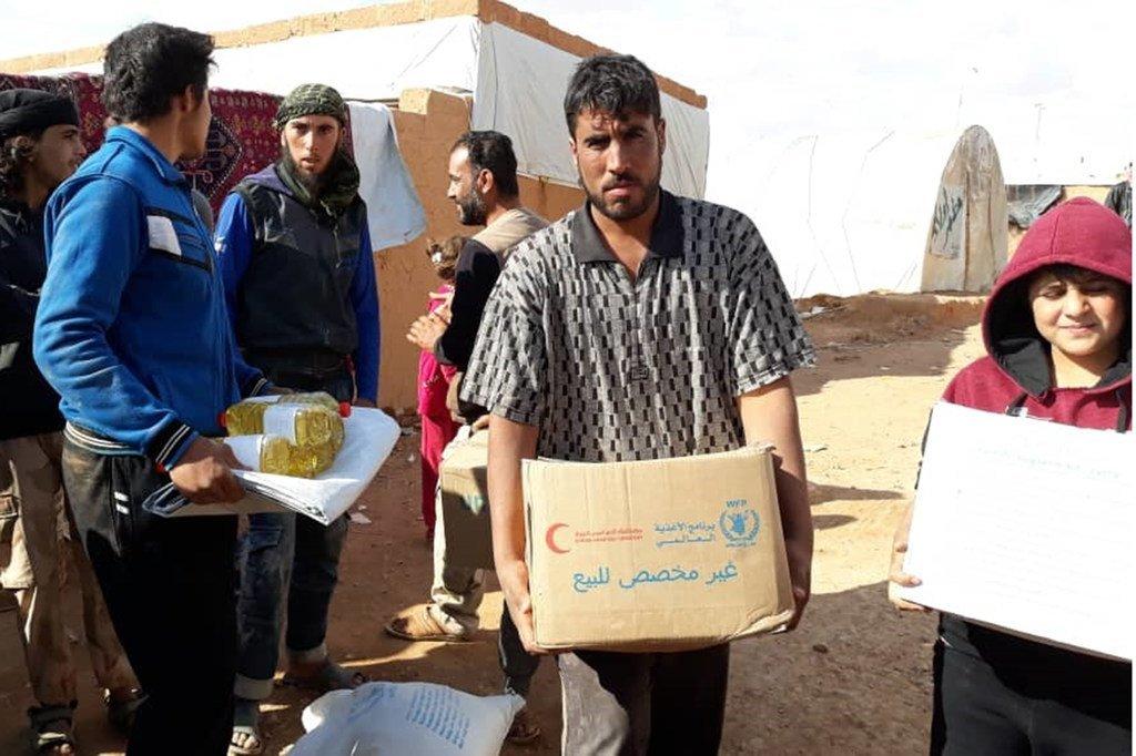Distribution d'assistance à Rukban, en Syrie.