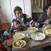 Des agriculteurs prenant leur repas dans le village de San Lorenzo, au Mexique.