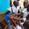 Learning that handwashing is among the best ways to protect yourself against Ebola, school children in Beni, DR Congo visit a UNICEF hand-washing station at their school.