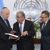 UN Secretary-General António Guterres (centre) meets with Malcolm Hoenlein (left), Executive Vice Chairman and CEO of the Conference of Presidents of Major American Jewish Organizations, who presents him with a book on the Kristallnacht Nazi pogrom.