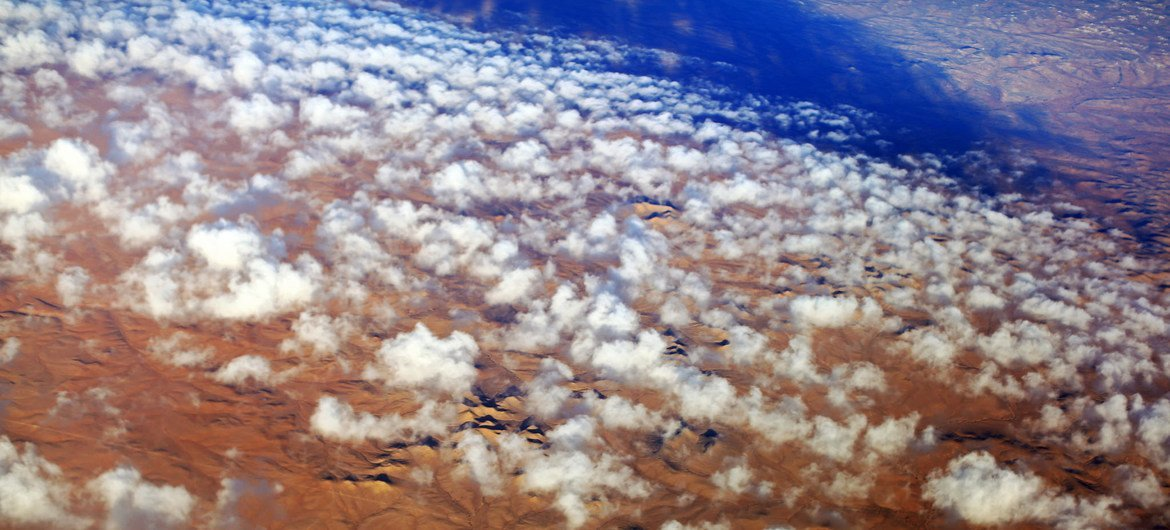 Clouds over the desert in southern Libya. Deserts form a large part of the country and human settlements are mostly found around oases.