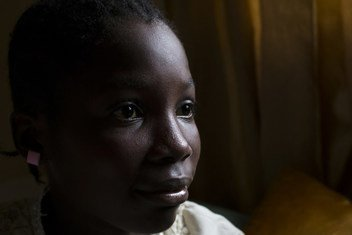 Stella, 12, sits on the bed she shares with her two siblings and mother. She was born in Nigeria but her birth was never registered.  Now living in Liberia, after the passing of her Nigerian father, she cannot prove ties to either country.