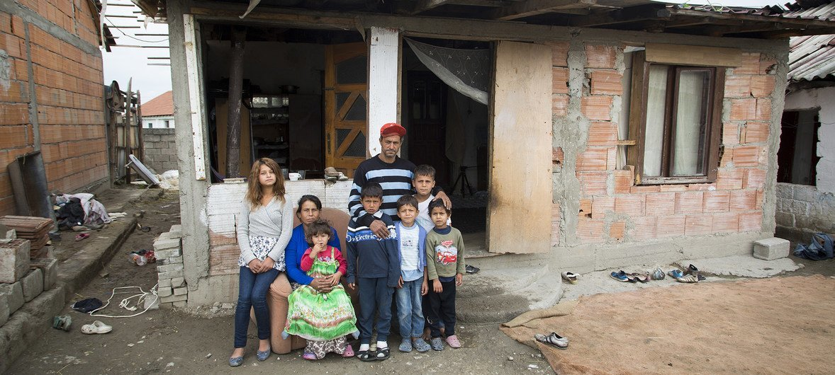 A family poses for a portrait at home after attending a UNHCR stateless workshop in Skopje, Macedonia.  Most stateless persons in the former Yugoslav Republic of Macedonia originate from other former Yugoslav republics. 2017.