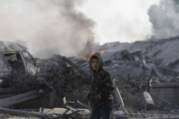 A 12-year-old boy walks past houses destroyed by Israeli airstrikes, in the city of Rafah, in the southern Gaza Strip. (November 2012)