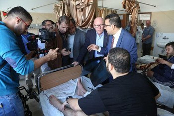 UN Humanitarian Coordinator for the Occupied Palestinian Territory, Jamie McGoldrick (centre), visits patients in Al-Shifa Hospital in Gaza, along with doctors and WHO's representative..