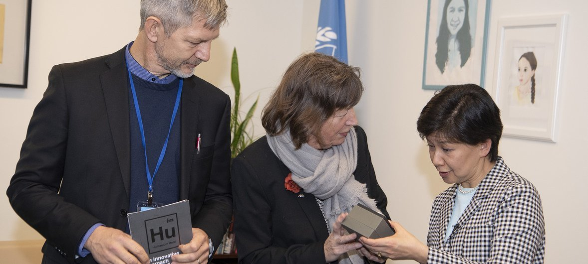The High Representative for Disarmament Affairs receives a symbolic gift to the UN from IM Swedish Development Partner. The wrist watch is made of metal stemming from seized illegal fire-arms in El Salvador.