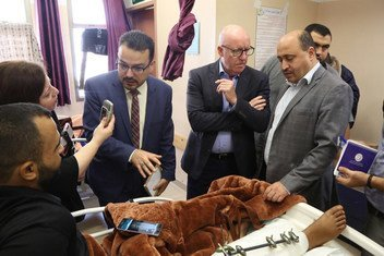 UN Humanitarian Coordinator for the Occupied Palestinian Territory, Jamie McGoldrick, visits patients in Al-Shifa Hospital in Gaza, along with doctors and WHO's representative.  Pictured l to r: UN News's Reem Abaza, Dr. Mattar and Jamie McGoldrick.