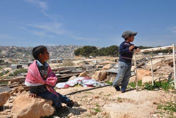 Bedouin boys living in Jabal al-Baba in the remains of their family's home which was demolished in 2017. (file photo)
