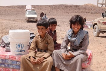 Displaced Yemeni boys sit on mattresses distributed as part of UNHCR's emergency relief effort in Sirwah,Yemen. More than two million Yemenis have been uprooted by the civil war which began in March 2015.