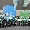 Un equipo de ciclistas en bicicletas eléctricas termina un paseo de 600 kilómetros en Katowice, sede de la 24 Conferencia de las Partes de la Convención sobre el Cambio Climático.