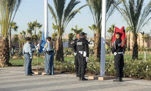 The Moroccan and United Nations flags are raised to mark the opening of the Global Compact for Migration conference in Marrakesh, Morocco.
