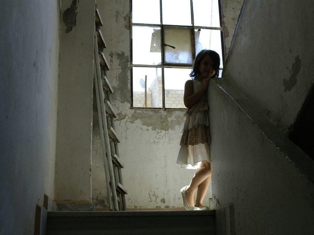 Une jeune fille de sept ans, en Syrie.