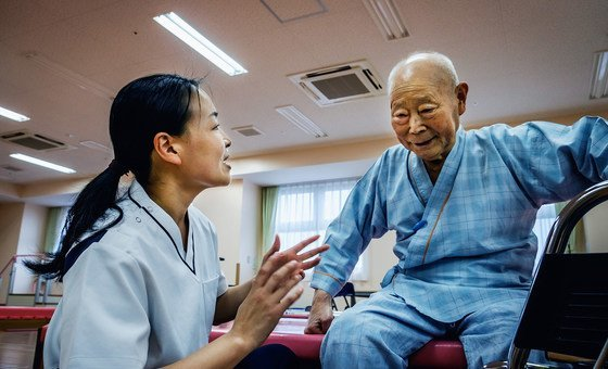An elderly patient receives rehabilitation care in Japan (file)