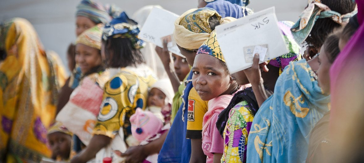 Central African mothers and children queue for food at the Timangolo refugee centre in Cameroon.