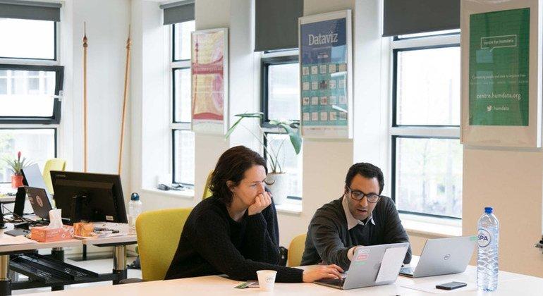 The Centre for Humanitarian Data's (UNOCHA) Lead, Sarah Telford, and Partnerships Manager, Kareem Elbayar at the centre.