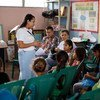 A teacher explains the importance of vaccination in the fight against cervical cancer.