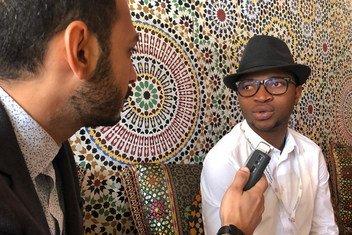 20-year-old Kader Diabate being interviewed by UN News's Mustafa Al Gamal in Marrakesh, Morocco.