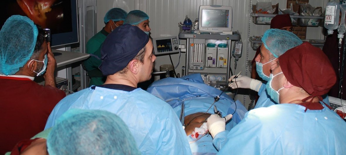 A team of surgeons in Al Jumhori Hospital in West Mosul, Ninewa Governorate, running the first laparoscopic surgery in the hospital. (December 2018)