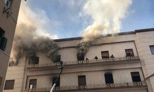Emergency personnel respond to the attack on the Libyan foreign ministry in Tripoli.