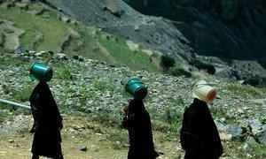 Women in Yemen travel hours each day for water.