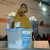 A woman casts her vote for elections in Puntland, on 13 November 2016.