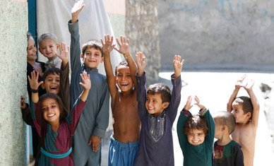 Afghan children show their fingers marked to indicate they have been vaccinated against polio.