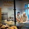Syrian refugee Mohamad Hamza Alemam (left) is receiving baking lessons from Master baker Björn Wiese (wearing cap), at the Backwerkstatt Bakery in Eberswalde, eastern Germany.  4 December 2018.
