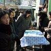 Женщины в Северной Корее, где 43 процента населения недоедает, пришли к пункту распределения гуманитарной помощи