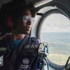 Marie-Roseline Darnycka Bélizaire, an epidemiologiist with the World Health Organisation team tackling the Ebola outbreak in the Democratic Republic of the Congo, travels by helicopter to Butembo in the east of the country.