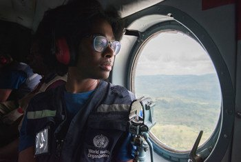 A member of the World Health Organization's (WHO) team tackling the Ebola outbreak in the Democratic Republic of the Congo travels by helicopter to Butembo in the east of the country in January 2019.