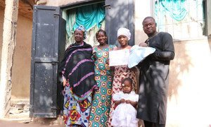 Fatouma in Mali  with her mother, brother, his wife and their children. Her family knows how important education is for the 19-year-old's future.