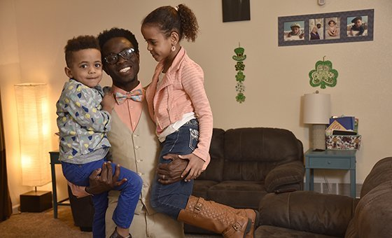 Bertine Bahige and his two children in their home in Gillette, Wyoming getting ready for the school day.
