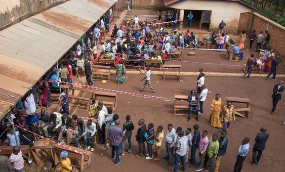 Voters lining up in front of polling stations during Presidential and Legislative elections in the Democratic Republic of the Congo (30 December 2018).
