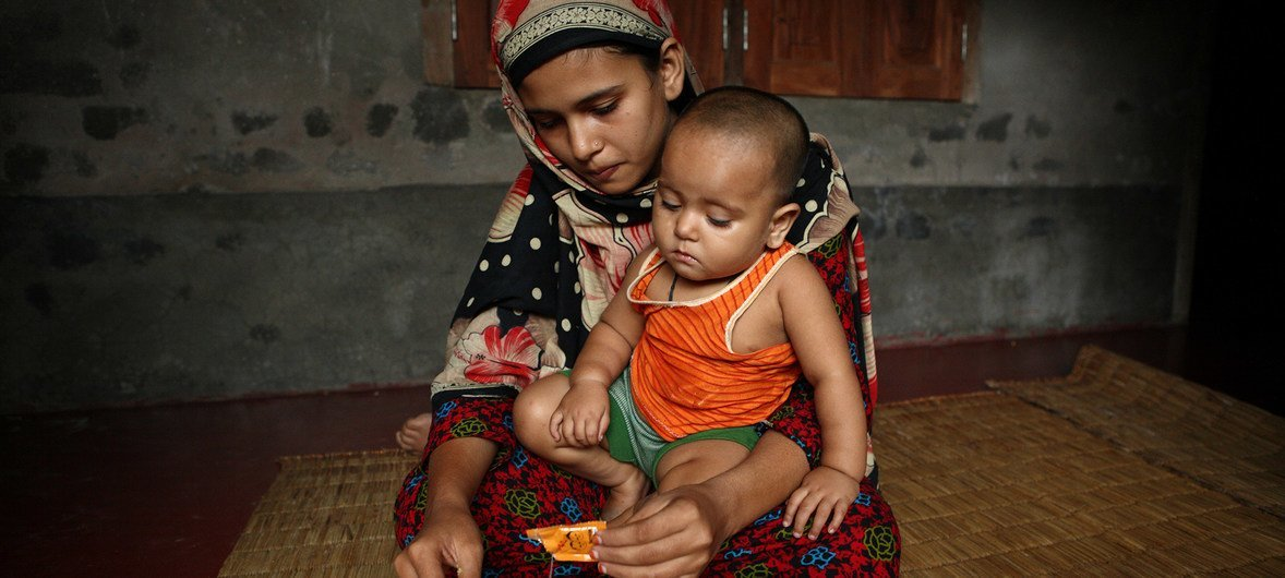 13 years old Sonamoni feeds her 11 months old daughter in Ashkarpur, Satkhira, Bangladesh. Sonamoni was married at the age of 8 years and 6 months to her husband who is now 29 years old. (file)