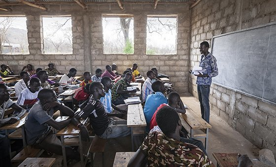 A South Sudanese refugee teaches a class at a primary school in Kule refugee camp, Ethiopia, March 2016.