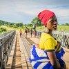 Jiran crossed a WFP-donated bridge to deliver her first-born child at Lugola health centre in Chikulo, Malawi.  (file)