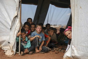 Children at a school tent in the northern Idlib, Syria. Humanitarian emergencies deprive children of health, nutrition, water and sanitation, education and other basic needs.