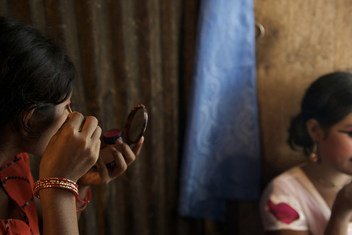 Two girls apply make-up at Kandapara, a brothel in the city of Tangail, Bangladesh. A man offered them to find them jobs, but instead sold them to Kandapara. (2009)