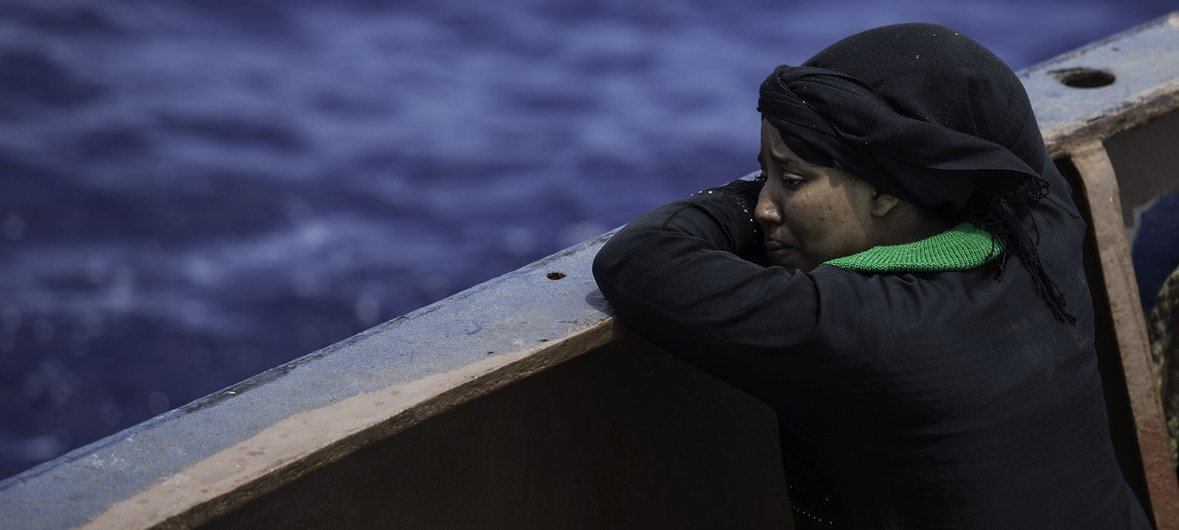 A woman weeps, minutes after being saved by the Sea Watch search and rescue ship, in Libya.