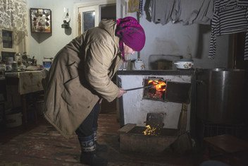 Living conditions of people in the conflict area in Eastern Ukraine. Stefania has been given four tons of coal by UNHCR, helping her to keep warm and cook.